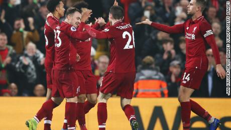 Xherdan Shaqiri (second left) celebrates his team's third goal in the 4-0 home win for Liverpool over Newcastle United.
