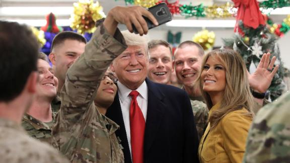U.S. President Donald Trump and First Lady Melania Trump greet military personnel at the dining facility during an unannounced visit to Al Asad Air Base, Iraq December 26, 2018. REUTERS/Jonathan Ernst     TPX IMAGES OF THE DAY