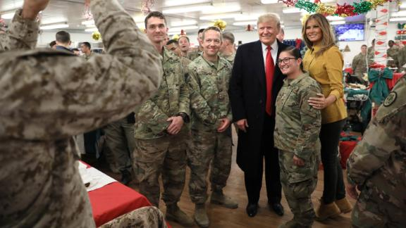 U.S. President Donald Trump and First Lady Melania Trump greet military personnel at the dining facility during an unannounced visit to Al Asad Air Base, Iraq December 26, 2018. REUTERS/Jonathan Ernst