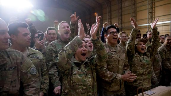 Members of the military cheer as President Trump speaks at the rally.