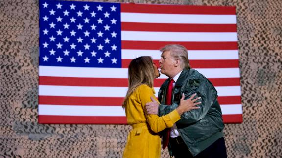 President Trump kisses the first lady during a hanger rally.