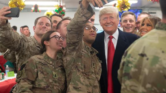 US President Donald Trump and First Lady Melania Trump greet members of the US military during an unannounced trip to Al Asad Air Base in Iraq on December 26, 2018.