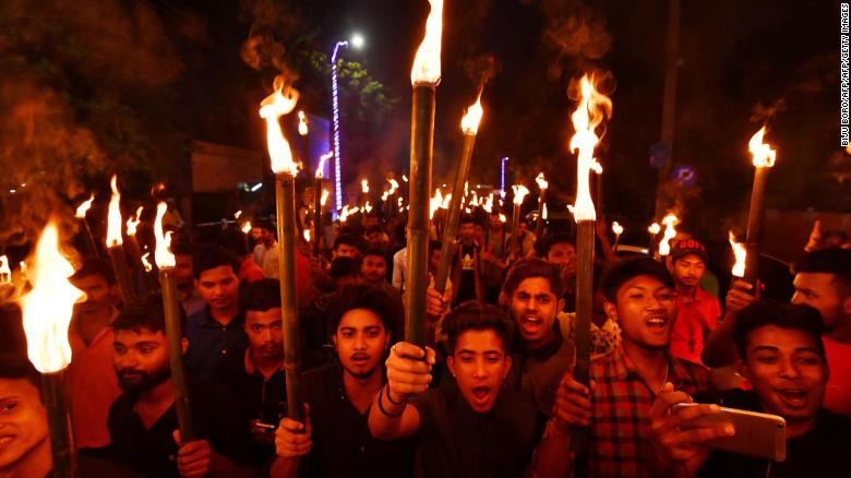 Activists of All Assam Students' Union (AASU) take part in a torch light procession in protest against the Citizenship (Amendment) Bill 2016 proposal to provide citizenship or stay rights to minorities from Bangladesh, Pakistan and Afghanistan in India, in Guwahati on May 14, 2018.