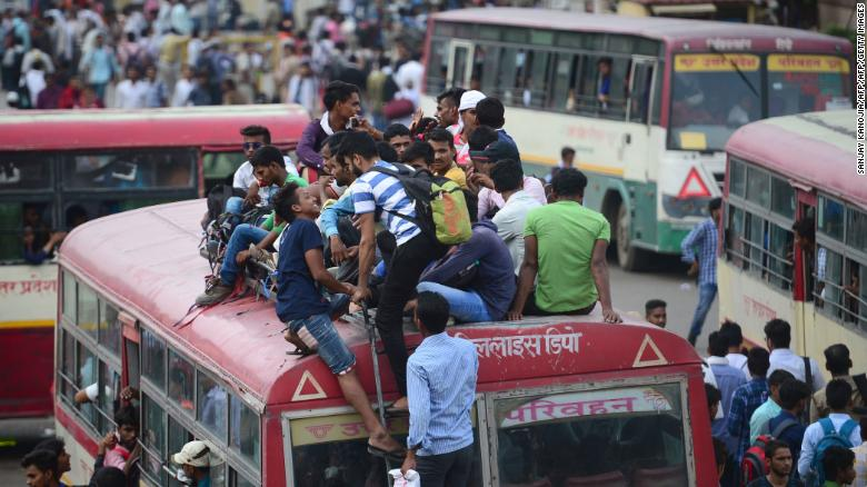 Indian applicants for the Uttar Pradesh police constable recruitment written examination sit on the roof of an overcrowded bus as they return home after examination, at civil lines bus stand, in Allahabad on June 18, 2018.