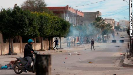 Tunisian protesters throw rocks at policemen during a demonstration on December 25, 2018 in the west-central Tunisian city of Kasserine.