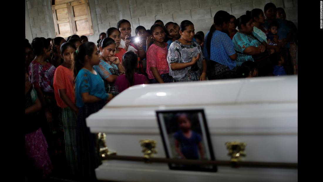 "Local residents attend the funeral of Jakelin Caal Maquin, <a href=""https://www.cnn.com/2018/12/23/americas/guatemala-jakelin-caal-maquin-returns-home/index.html"" target=""_blank"">a 7-year-old girl who died in US Customs and Border Protection custody</a>, at her home village in Guatemala on December 25."