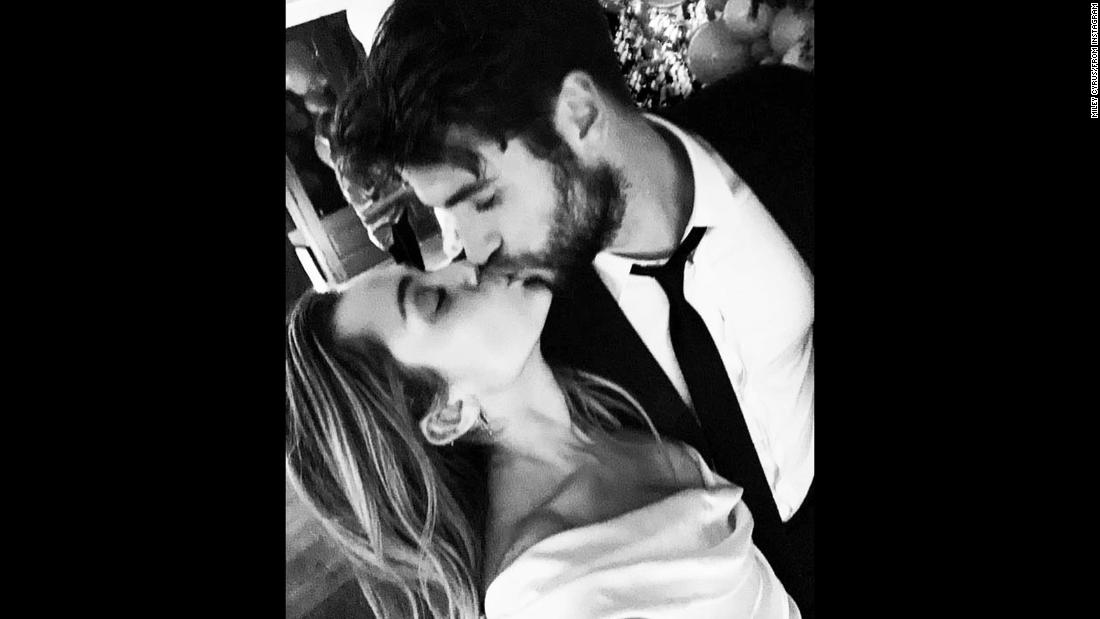 "Newlyweds Miley Cyrus and Liam Hemsworth kiss in an Instagram post after <a href=""https://www.cnn.com/2018/12/26/entertainment/miley-cyrus-liam-hemsworth-married/index.html"" target=""_blank"">getting married</a> on Wednesday, December 26."