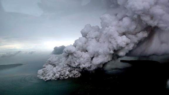 TOPSHOT - This aerial picture taken on December 23, 2018 by Bisnis Indonesia shows the Anak (Child) Krakatoa volcano erupting in the Sunda Straits off the coast of southern Sumatra and the western tip of Java. - The death toll from the December 22 volcano-triggered tsunami in Indonesia has risen to 281, with more than 1,000 people injured, the national disaster agency said on December 24, as the desperate search for survivors ramped up. (Photo by Nurul HIDAYAT / BISNIS INDONESIA / AFP)        (Photo credit should read NURUL HIDAYAT/AFP/Getty Images)