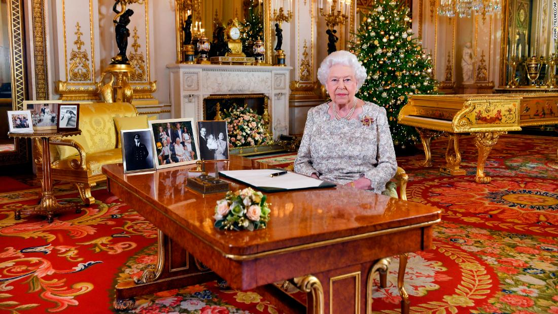 "In this image released on Tuesday, December 25, Britain's Queen Elizabeth poses for a photograph after she recorded her <a href=""https://www.cnn.com/2018/12/24/uk/queen-elizabeth-christmas-message-intl-gbr/index.html"" target=""_blank"">annual Christmas Day message</a>, in Buckingham Palace, London."