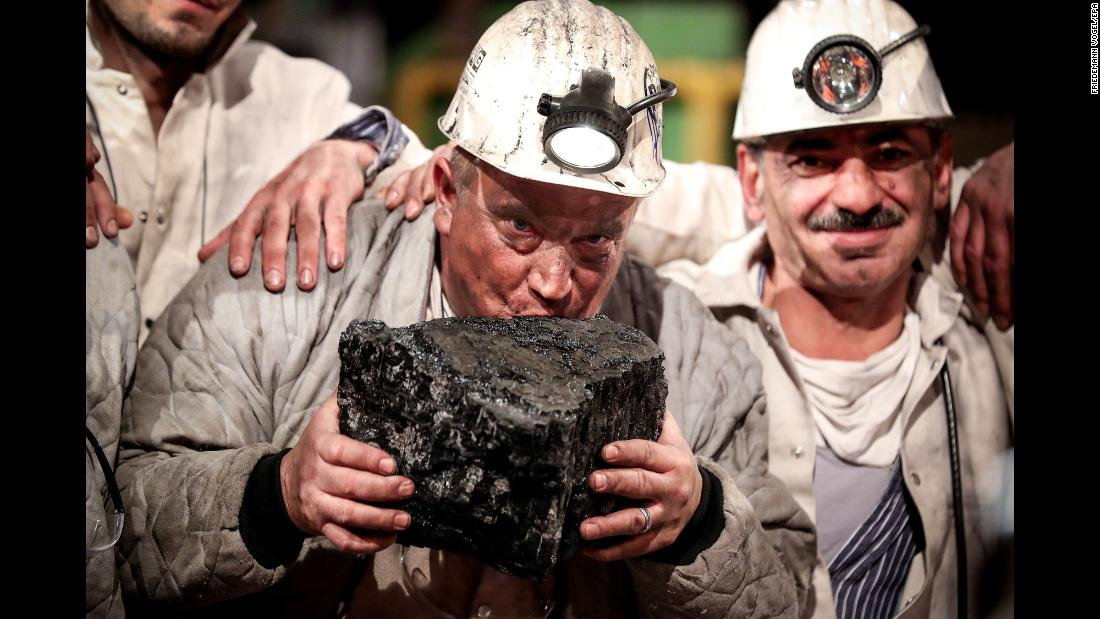 Miner Jürgen Jakubeit kisses the last piece of hard coal mined at the German coal mine Prosper-Haniel during a farewell ceremony for the mine in Bottrop, Germany, on December 21. Prosper-Haniel was the last surviving black coal mine in Germany.