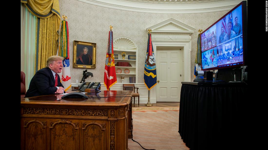 President Donald Trump makes a video call from the Oval Office on Christmas day, December 25, to service members from the Army, Marine Corps, Navy, Air Force, and Coast Guard stationed worldwide.