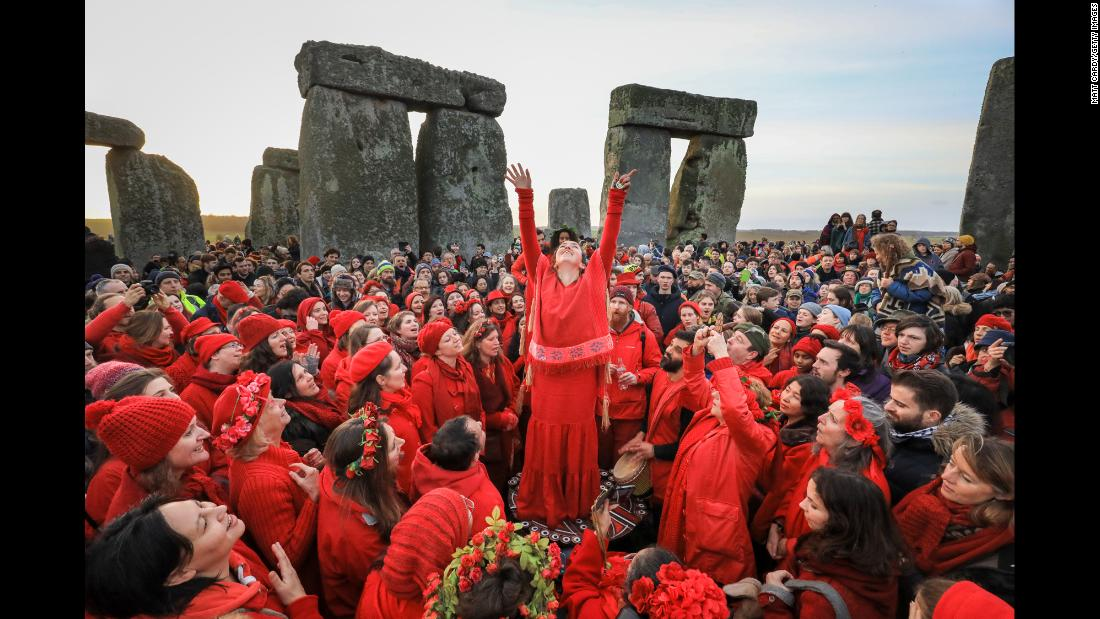 "Members of the Shakti Sings Choir sing in the center of Stonehenge as they take part in a winter solstice ceremony on December 22 in Wiltshire, England. <a href=""https://www.cnn.com/2018/12/20/world/gallery/week-in-photos-1221/index.html"" target=""_blank"">See last week in 29 photos.</a>"