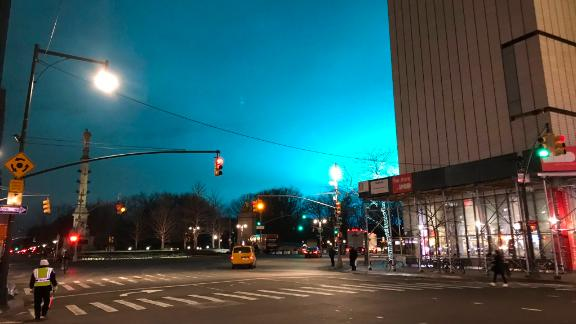 Manhattan's sky lights up in an eerie shade of blue Thursday night, as seen from Columbus Circle.