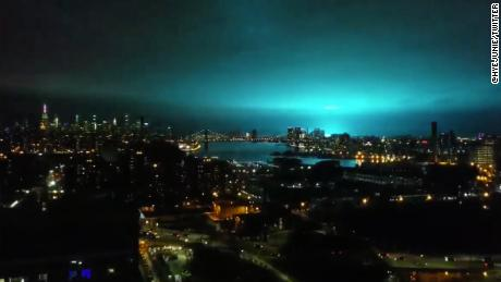 The blue light from the transformer explosion, as seen from Brooklyn.