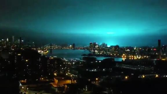 The blue light appears after an electrical flash at a Con Edison substation, as seen from Brooklyn.