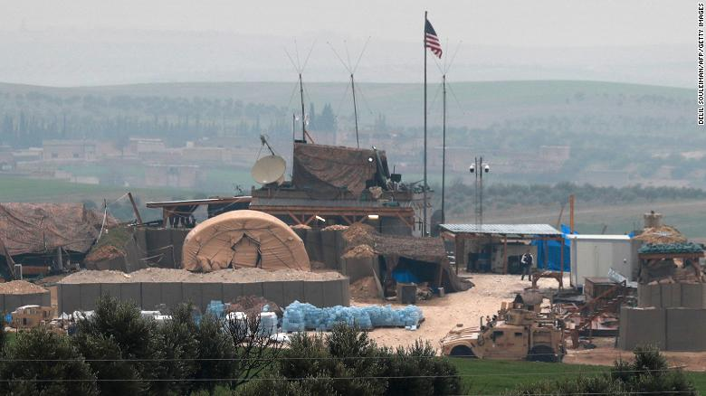US forces' vehicles and structures are seen Wednesday on the outskirts of Manbij, Syria.