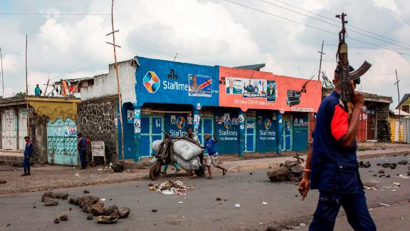 TOPSHOT - Congolese National Police patrol the street on December 28, 2018 at Majengo in Goma, in North Kivu province. - One of the world's powder-keg countries faces a crunch test on December 30 when Democratic Republic of Congo heads into elections marred by delays, clashes and fears of polling-day chaos as electoral authorities have postponed the vote until March in Beni and Butembo in North Kivu province (eastern RDCongo), and in Yumbi (western RDCongo). (Photo by PATRICK MEINHARDT / AFP)        (Photo credit should read PATRICK MEINHARDT/AFP/Getty Images)