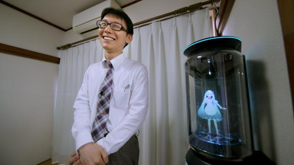 Kondo smiles next to his new bride Hatsune Miku.