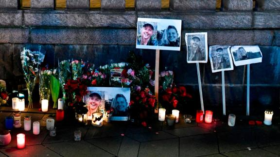 Flowers, candles and photos in memory of the two Scandinavian victims are left at the Town Hall Square in Copenhagen, Denmark, on Friday, December 28.