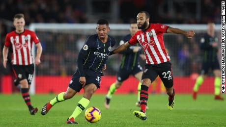 Gabriel Jesus of Manchester City battles with Southampton's Nathan Redmond.
