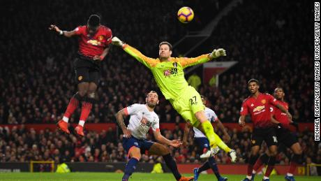 Manchester United's Paul Pogba beats Asmir Begovic of AFC Bournemouth as he scores the Red Devils' second goal.