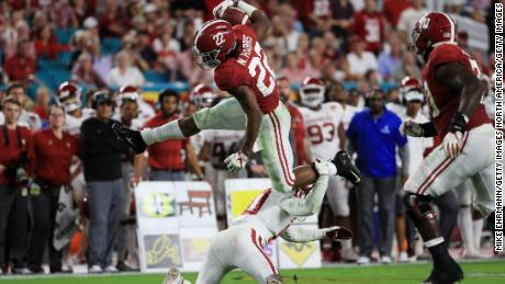 Najee Harris of the Alabama Crimson Tide carries the ball against the Oklahoma Sooners during the College Football Playoff Semifinal at the Capital One Orange Bowl.