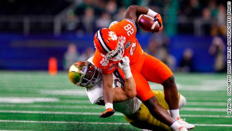 Drue Tranquill of the Notre Dame Fighting Irish tackles Clemson Tigers' Tavien Feaster in the second half during the College Football Playoff Semifinal Goodyear Cotton Bowl Classic.