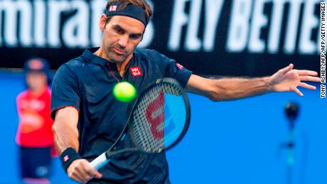 Switzerland's Roger Federer hits a return against Cameron Norrie of Britain during their men's singles match on day two of the Hopman Cup.