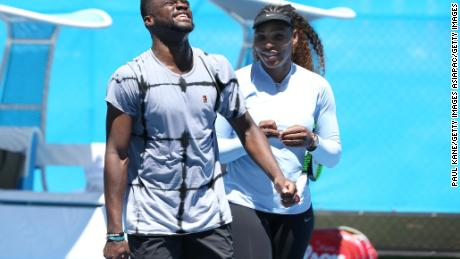 US' Frances Tiafoe and Serena Williams share a moment on the practice court during day two.