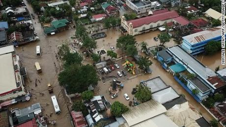 An aerial photograph shows flooding in the town of Baao in Camarines Sur province on December 30.