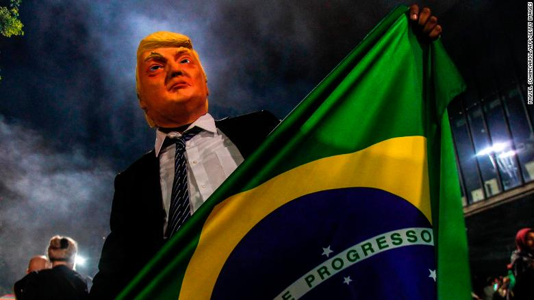A Bolsonaro supporter in a Trump mask celebrates in the wake of October's election.