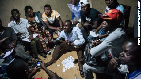 Improvised electoral agents count ballots after a symbolic vote on December 30, 2018, at Kalinda Stadium in Beni, where voting in the general election was postponed.