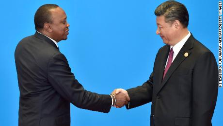 Kenyan President Uhuru Kenyatta (left) shakes hands with Chinese President Xi Jinping the hand during the welcome ceremony for the Belt and Road Forum near Beijing in May 2017.