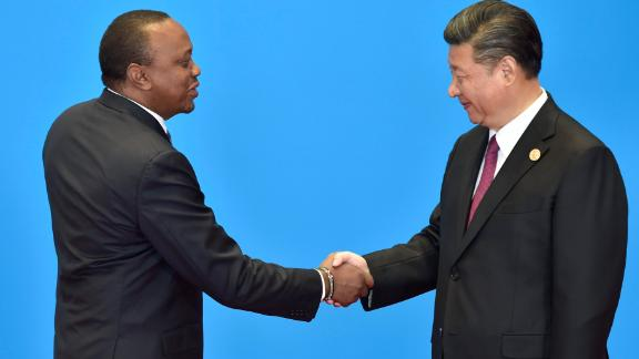 Kenya's President Uhuru Kenyatta (left) shakes hands with Chinese President Xi Jinping during the welcome ceremony for the Belt and Road Forum, near Beijing in May 2017.
