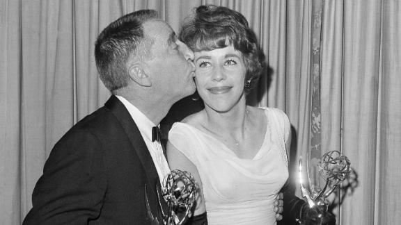 """Garry Moore kisses Burnett in 1962 after they both received Emmy Awards for their work on """"The Garry Moore Show."""""""