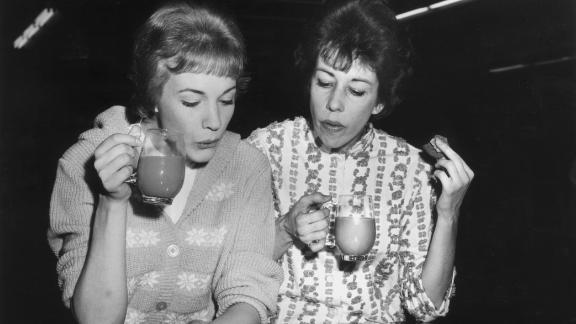 """Julie Andrews, left, and Burnett drink tea while reviewing the musical score for their 1962 TV special """"Julie and Carol at Carnegie Hall."""""""
