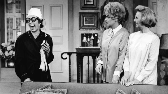 """Burnett laughs while appearing with Lucille Ball, center, and Mary Jane Croft on a 1966 episode of """"The Lucy Show."""""""