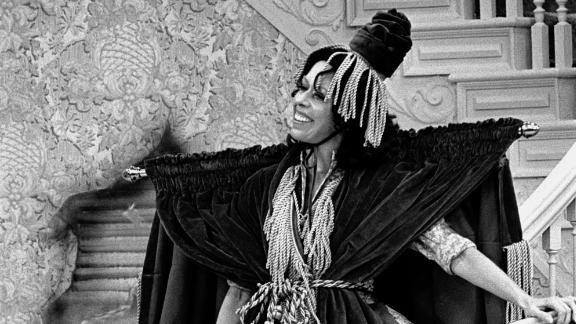 """Burnett wears a dress made from a window curtain as she parodies """"Gone With the Wind"""" during a """"Carol Burnett Show"""" episode in 1976."""