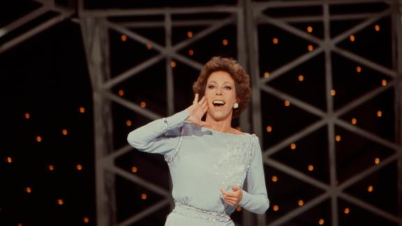 Burnett performs a Tarzan yell, which she would often do during her show's question-and-answer sessions.