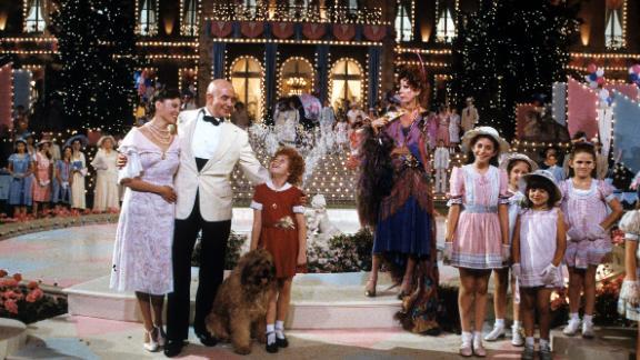 "Burnett co-stars in the 1982 musical film ""Annie."""