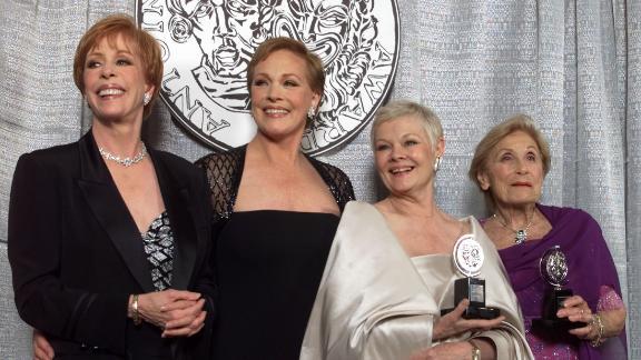 From left, Burnett, Julie Andrews, Judi Dench and Isabelle Stevenson pose for a photo at the Tony Awards in 1999.