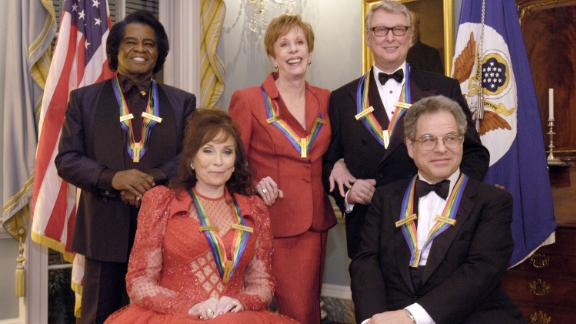 Burnett, center, poses with other Kennedy Center honorees in 2003. Joining her, from left, are singer James Brown, singer Loretta Lynn, film director Mike Nichols and violinist Itzhak Perlman.