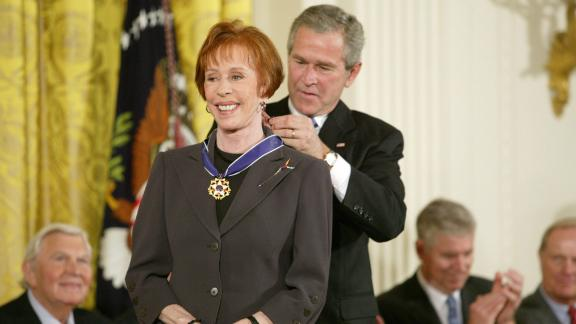"""President George W. Bush awards Burnett the Presidential Medal of Freedom in 2005. Burnett was honored """"for enhancing the lives of millions of Americans and for her extraordinary contributions to American entertainment."""""""