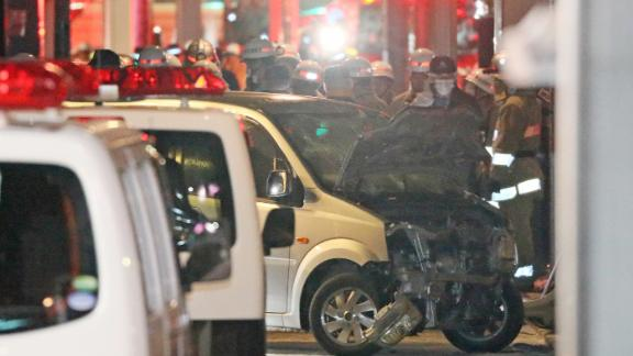 Police inspect a car whose driver rammed his vehicle into crowds on Takeshita street in Tokyo early January 1, 2019. - Nine people were hurt, one seriously, when a man deliberately ploughed his car into crowds celebrating New Year's Eve along a famous Tokyo street, police and media said on January 1. (Photo by JIJI PRESS / JIJI PRESS / AFP) / Japan OUT        (Photo credit should read JIJI PRESS/AFP/Getty Images)