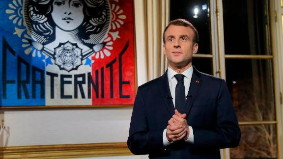 French President Emmanuel Macron delivers his New Year wishes during a televised address to the nation from the Elysee Palace in Paris on December 31, 2018. (Photo by Michel Euler / POOL / AFP)        (Photo credit should read MICHEL EULER/AFP/Getty Images)