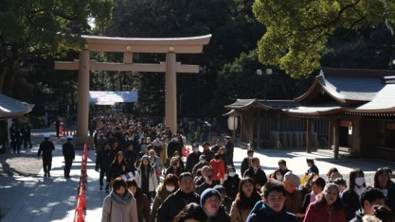 People make their way to offer prayers on the first day of the new year at Meiji Shrine in Tokyo.