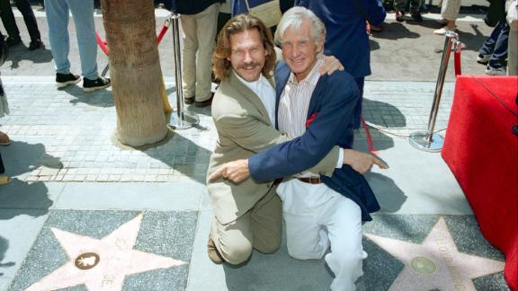 Bridges and his dad point to each other's star on the Hollywood Walk of Fame in 1994.