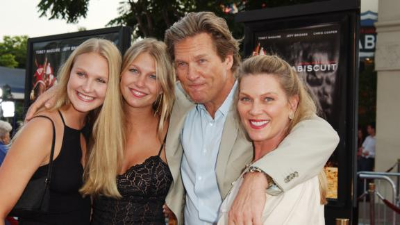 "Bridges poses with his wife and two of his daughters at the Los Angeles premiere of the 2003 movie ""Seabiscuit."""