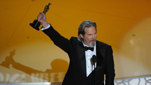 "Bridges holds up the best actor Oscar that he won in 2010 for his role in ""Crazy Heart."""