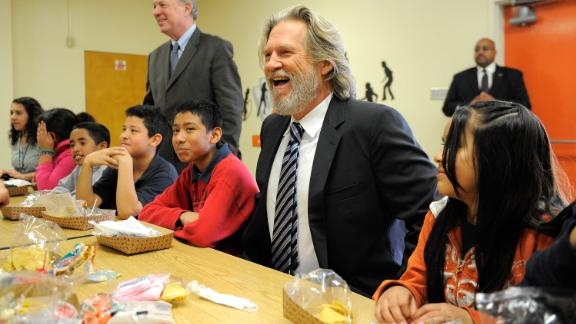 "Bridges poses with elementary school students in Los Angeles at the launch of the ""No Kid Hungry"" campaign in 2011. In 1983, Bridges founded the End Hunger Network, a nonprofit organization dedicated to feeding children around the world."